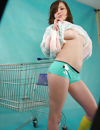Naked teen in a shopping-cart
