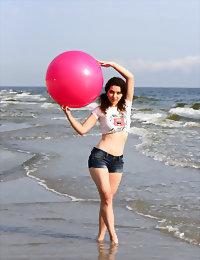 Cute angel on the beach