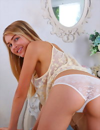 Blonde angel on the couch