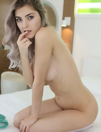 Posing and getting naked