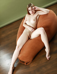 Barbara shows off her yummy pussy and sweet cheeks on bag chair